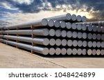 heap of aluminium bar in... | Shutterstock . vector #1048424899