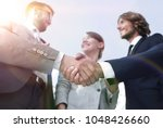 in the foreground.handshake of... | Shutterstock . vector #1048426660