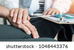 geriatric doctor consulting and ... | Shutterstock . vector #1048443376