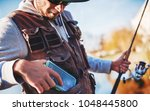 fisherman enjoys in fishing on... | Shutterstock . vector #1048445800