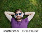 happy man listening to music...   Shutterstock . vector #1048448359