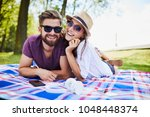 young couple looking at camera... | Shutterstock . vector #1048448374