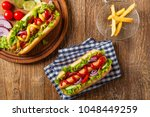 delicious homemade hot dogs.... | Shutterstock . vector #1048449259