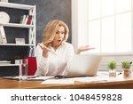 emotional businesswoman working ... | Shutterstock . vector #1048459828