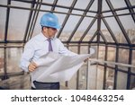 on the roof of the building ... | Shutterstock . vector #1048463254