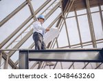 on the roof of the building ... | Shutterstock . vector #1048463260