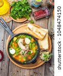 soup with quail meat  with... | Shutterstock . vector #1048474150