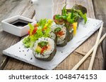 healthy kale and avocado sushi... | Shutterstock . vector #1048474153