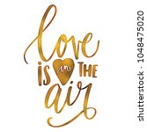 love is in the air calligraphy | Shutterstock .eps vector #1048475020