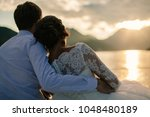 wedding couple travel at sunset.... | Shutterstock . vector #1048480189