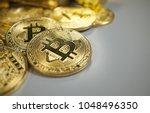golden bitcoin coin and gold....   Shutterstock . vector #1048496350