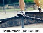 legs walking on steel pipe with ... | Shutterstock . vector #1048500484