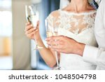 tenderness of the bride and... | Shutterstock . vector #1048504798