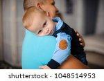 little boy looks over the... | Shutterstock . vector #1048514953