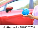 saving money and loans for car... | Shutterstock . vector #1048525756