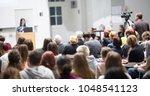 female speaker giving... | Shutterstock . vector #1048541123