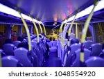 inside a bus drive through...   Shutterstock . vector #1048554920
