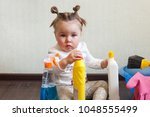 child playing with bottles with ...   Shutterstock . vector #1048555499