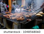 grilling meat with barbecue...   Shutterstock . vector #1048568060