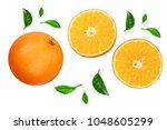 orange with slice and leaf... | Shutterstock . vector #1048605299