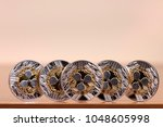 several aligned ripple coins on ... | Shutterstock . vector #1048605998