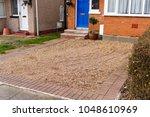 loose pebblestone flooring... | Shutterstock . vector #1048610969
