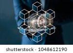businessman touching tablet... | Shutterstock . vector #1048612190