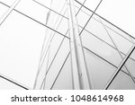 Small photo of An architectural abstraction. This architectural abstraction is made up of multiple lines that form rectangles and squares. Lines of different colors from gray to black.