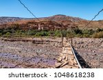 berber village in the atlas... | Shutterstock . vector #1048618238