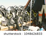 diving equipment on board the... | Shutterstock . vector #1048626833