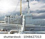 frozen ship in thick ice crust... | Shutterstock . vector #1048627313