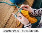 young girl knitting a circle... | Shutterstock . vector #1048630736