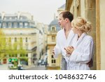 happy young couple in white... | Shutterstock . vector #1048632746
