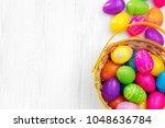 easter eggs in basket on wooden ... | Shutterstock . vector #1048636784