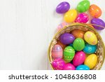 easter eggs in basket on wooden ... | Shutterstock . vector #1048636808
