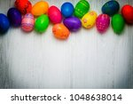 colorful easter eggs on wooden... | Shutterstock . vector #1048638014