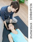 trainer doing special therapy... | Shutterstock . vector #1048649156