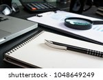 office desk table with supplies.... | Shutterstock . vector #1048649249