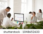 diverse colleagues talking... | Shutterstock . vector #1048652633