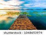 A Bamboo Dock Leading Onto Taa...