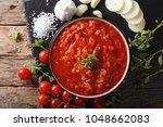 neapolitan fresh pizzaiola... | Shutterstock . vector #1048662083