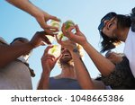 happy young friends toasting... | Shutterstock . vector #1048665386