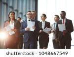 large group of young and mature ... | Shutterstock . vector #1048667549