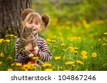 Stock photo funny lovely little girl playing with a cat 104867246