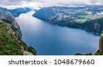 Norway, Scandinavia, Europe. Spectacular view on Lysefjord and Norwegian iconic landmark Preikestolen  pulpit rock. Traditional northern Norwegian nature landscape. Travel to Scandinavia background.