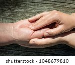 young woman holding the hand of ...   Shutterstock . vector #1048679810