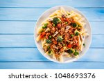 penne with meat  tomato sauce... | Shutterstock . vector #1048693376