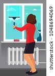 woman washing the window with a ... | Shutterstock .eps vector #1048694069