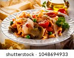 pasta with vegetables on wooden ... | Shutterstock . vector #1048694933
