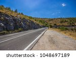 a coast road by the sea in... | Shutterstock . vector #1048697189